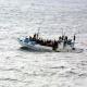 Vluchtelingen op een boot op de Middellandse Zee